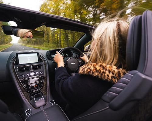 Elysia driving Aston Martin