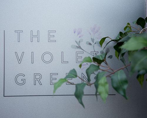 The Violet Green signage
