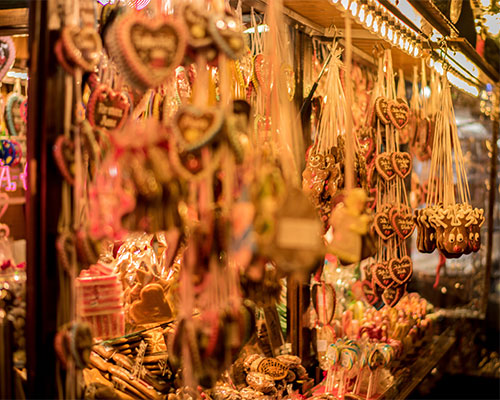 Christmas biscuits and decorations hanging on a Christmas market stall.