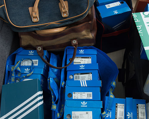 A huge collection of trainer boxes and bags.