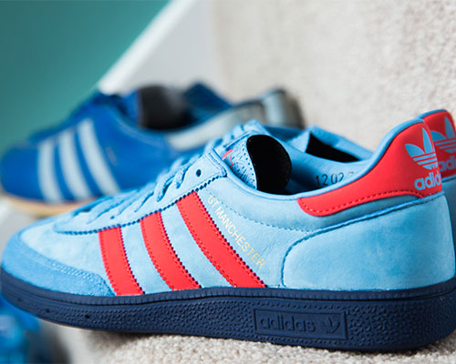 Blue and red adidas trainers
