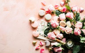 Pink background with flowers and treats